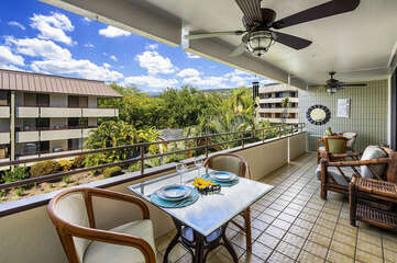 Lanai with Outdoor Dining Set for Two, Sofa, and Ceiling Fan