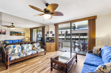 Living Area with Easy Access to Lanai, Sofas, Smart TV, and Ceiling Fan