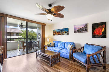 Sofa, Armchair, Ceiling Fan, and Sliding Doors to the Lanai