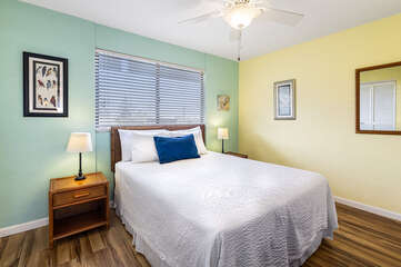 Bedroom with Large Bed, Ceiling Fan, and Nightstands