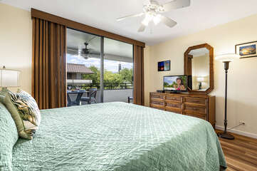 Large Bed, Drawer Dresser, Mirror, Ceiling Fan, and Sliding Doors to Lanai