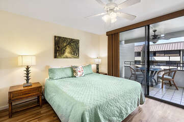 Bedroom with Sliding Doors to Lanai, Large Bed, and Ceiling Fan