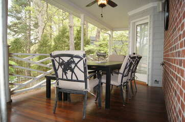 Table for 6+ on main level covered deck. Ceiling fans to keep cool in summer!