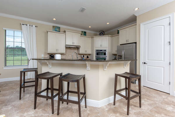 Have a snack at the breakfast bar with seating for 4