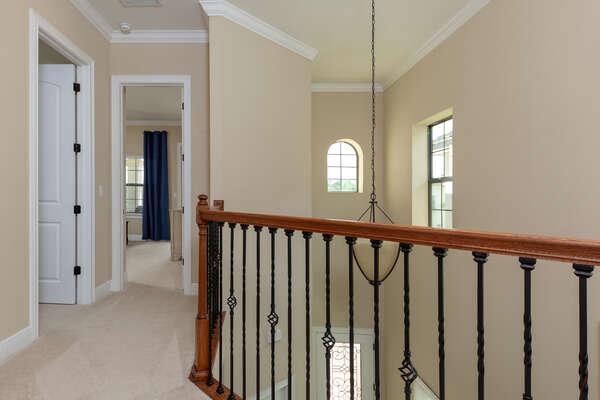 The second floor features more bedrooms and places to spend time together as a family