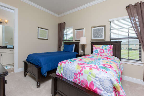 Kids will love this fun bedroom with two twin beds