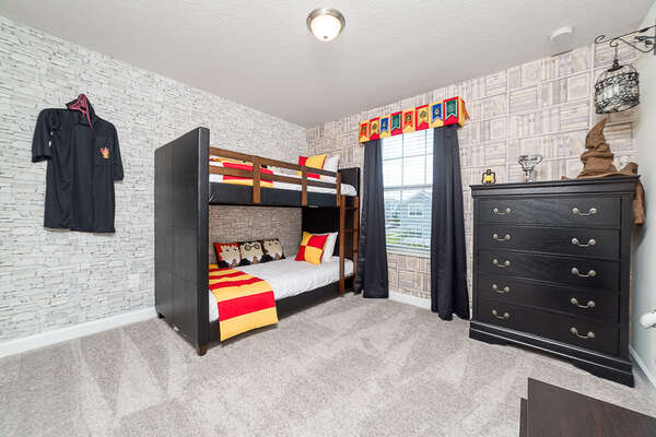 An upstairs bedroom with a magical twin/twin bunk