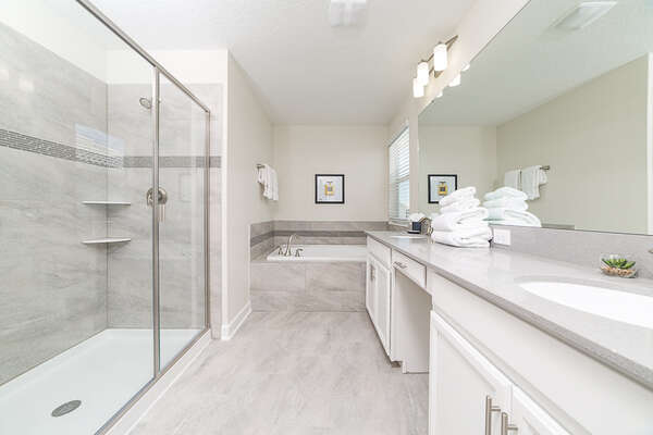The ensuite master bathroom complete with a walk in shower and tub