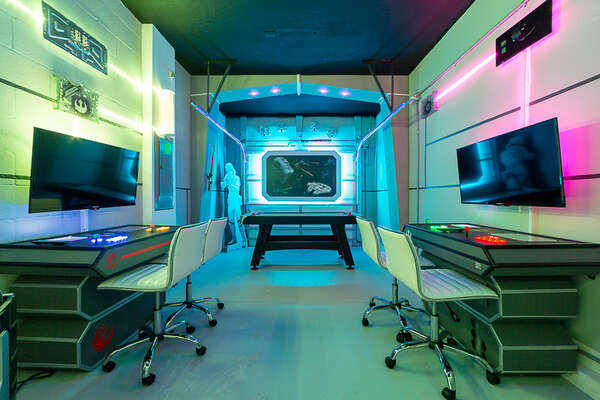 This fun themed game room has unique lighting to enhance the environment