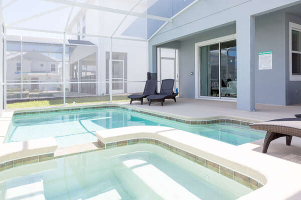 Enjoy the Florida sunshine at your very own screened-in private pool and spa