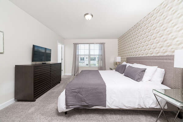 Upstairs master with a King sized bed and TV