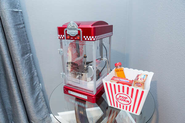 This theater even comes with a small popcorn maker to give you a full movie night experience