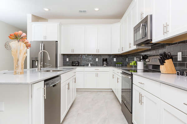 The kitchen is pristine and is fully equipped with anything you may need for your stay