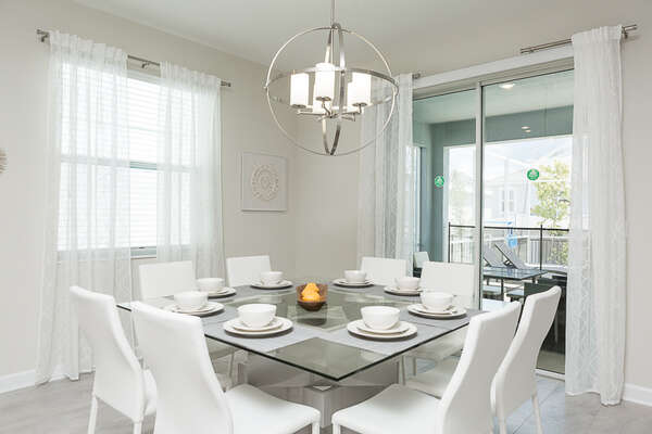 The elegant dining area seats 8 and has access to the patio