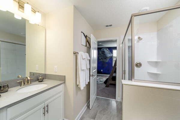 The Jack and Jill bathroom connects the kids' room to another king bedroom