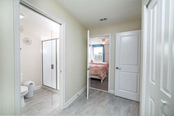 The Jack and Jill bathroom is shared with the kids' bedroom