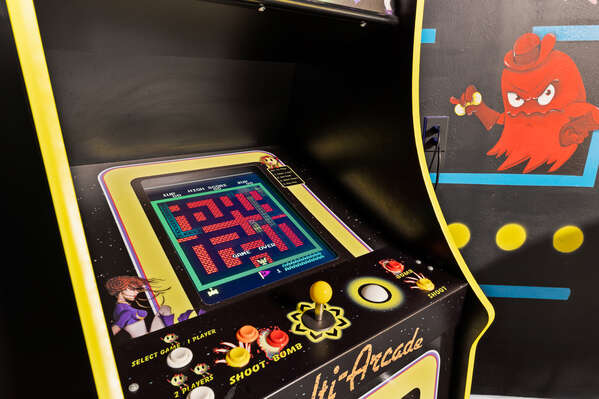 The game room is full of un-filled activities, such as an arcade machine