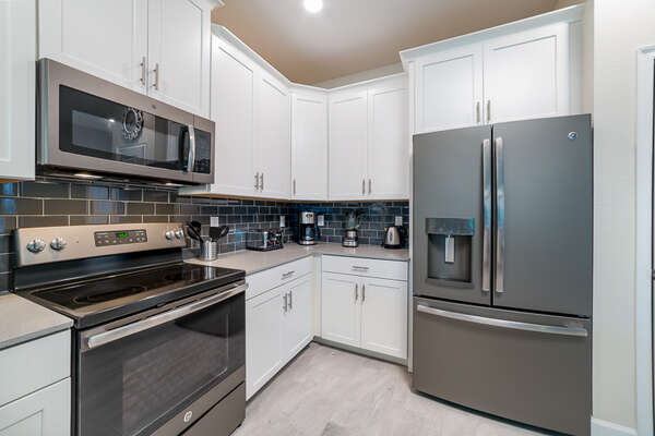 Kitchen is stocked with modern appliances