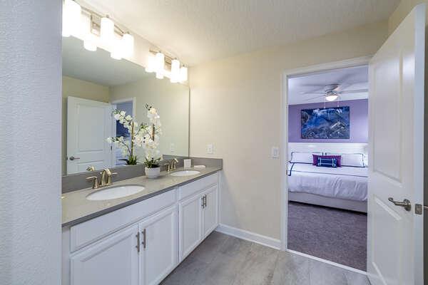 Ensuite Jack and Jill bathroom has dual sinks