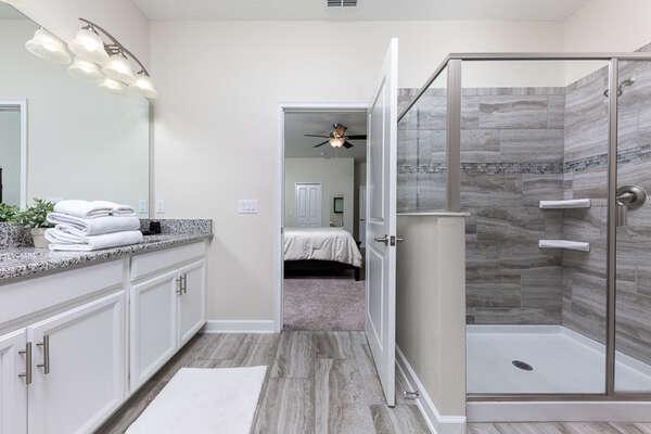 Spacious en-suite bathroom with a walk-in shower