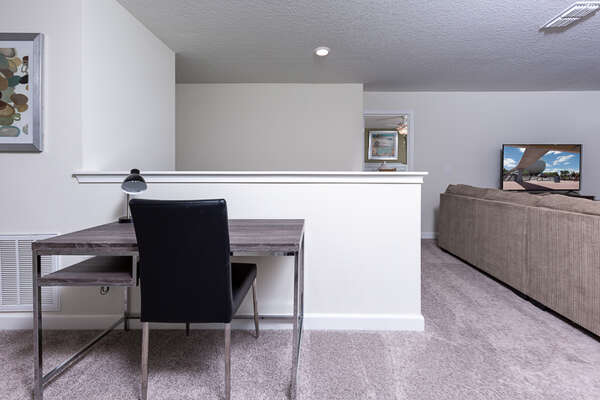 Upstairs loft comes with a desk and chair for your use and convenience