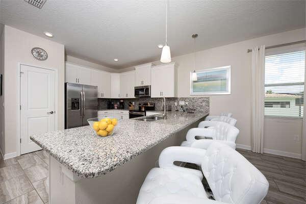 The entire kitchen area has a simple but elegant design