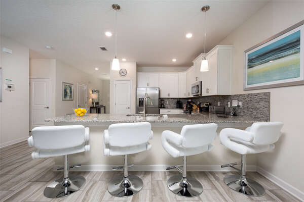 The kitchen includes 4 bar stools for a more informal setting to enjoy breakfast in