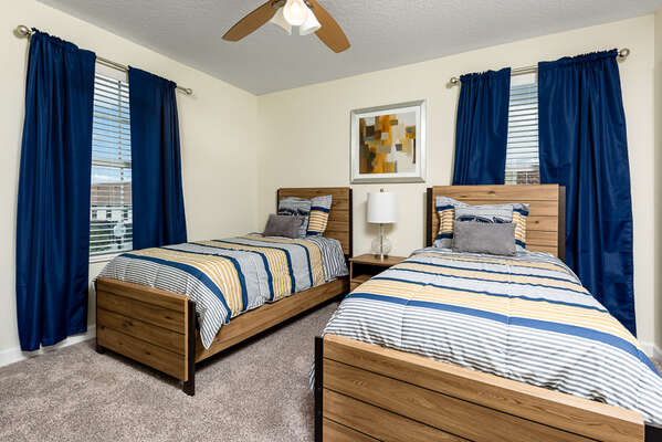 This bedroom features two twin beds