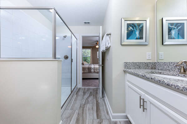 It features a large walk-in shower