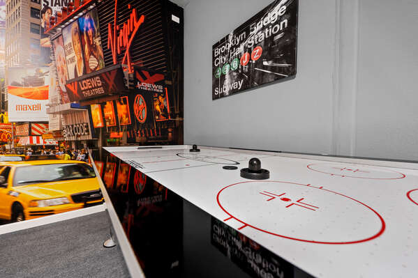 Play a game of air hockey in front of your own New York cityscape