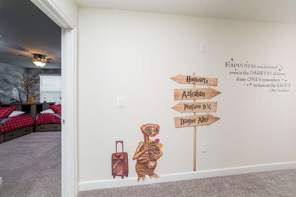 The hallway brings out your inner child with wall decorations from your favorite movies