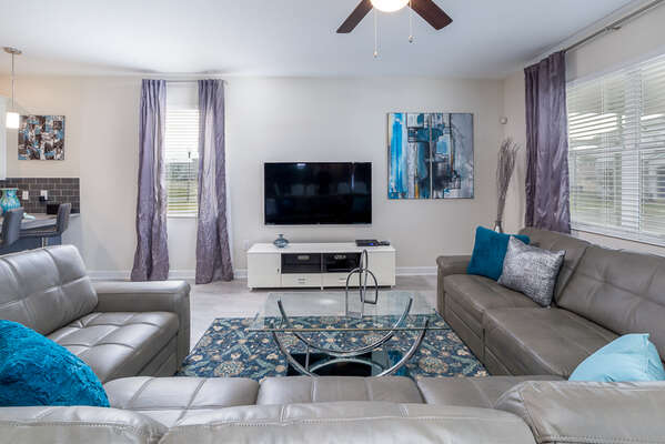 Beautiful living area with comfortable sectional and TV