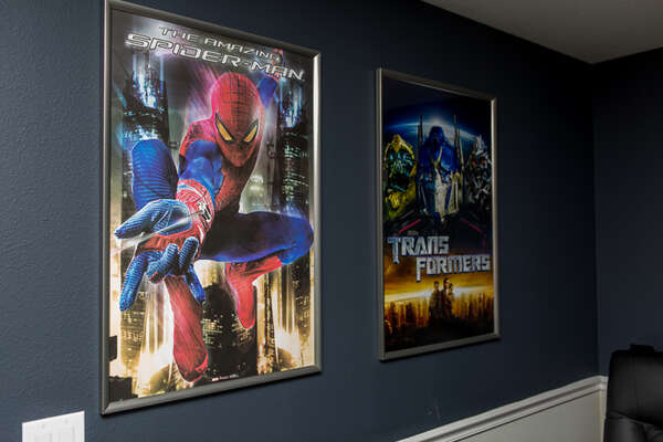 Posters from your favorite movies help drive home the theater atmosphere
