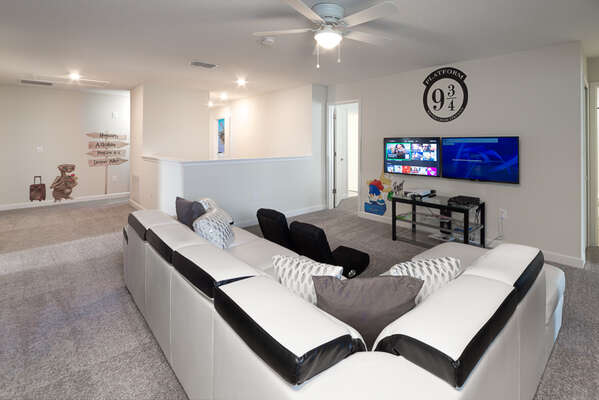 The loft has a 2 large screen TVs for family movie or game time