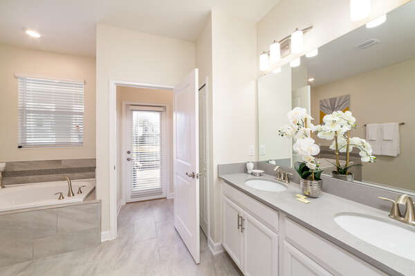 This ensuite bathroom gives you private access to the pool area