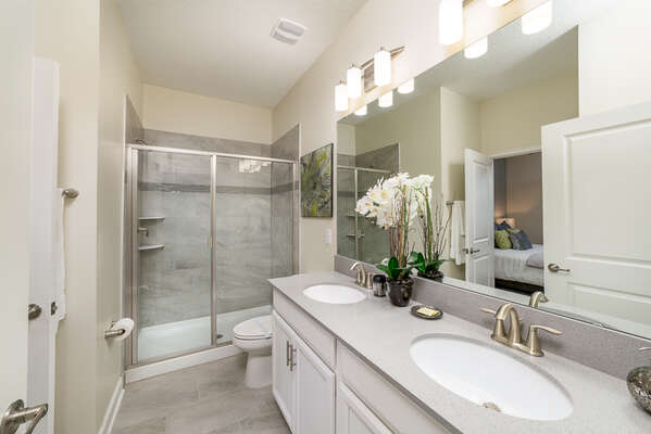The ensuite bathroom features a walk-in shower