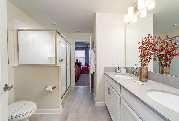 A Jack-n-Jill bathroom with walk-in shower
