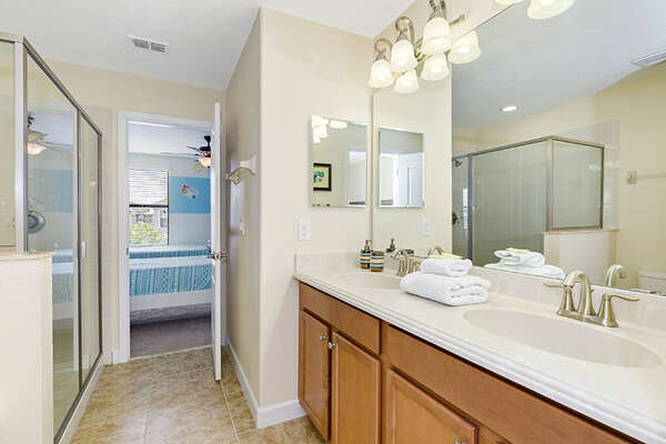 A Jack-n-Jill bathroom with walk-in shower