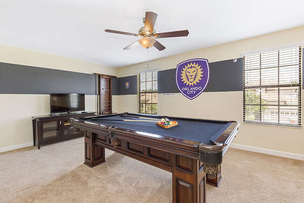Let the fun continue at home with a pool table and TV