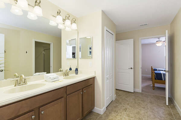 Jack-n-Jill bathroom with a walk-in shower