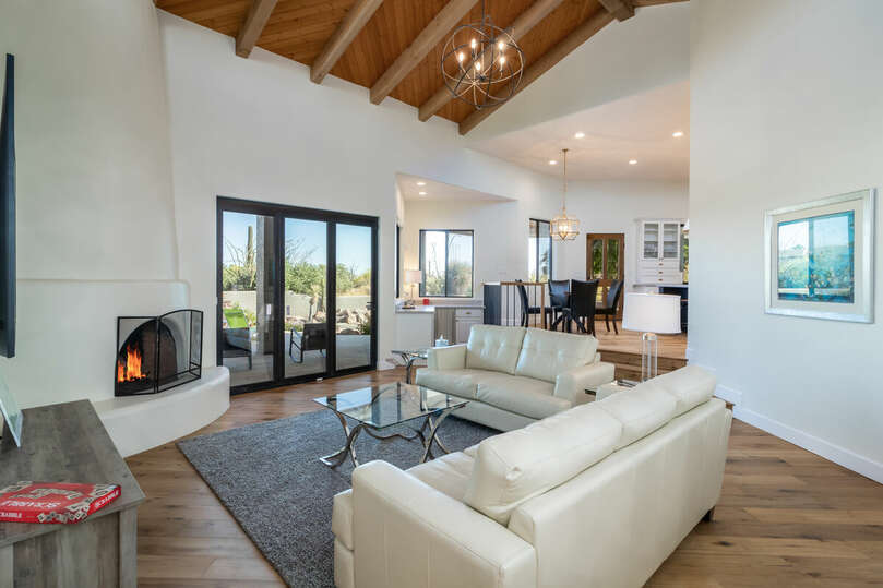 Large living area with high, wood ceilings.