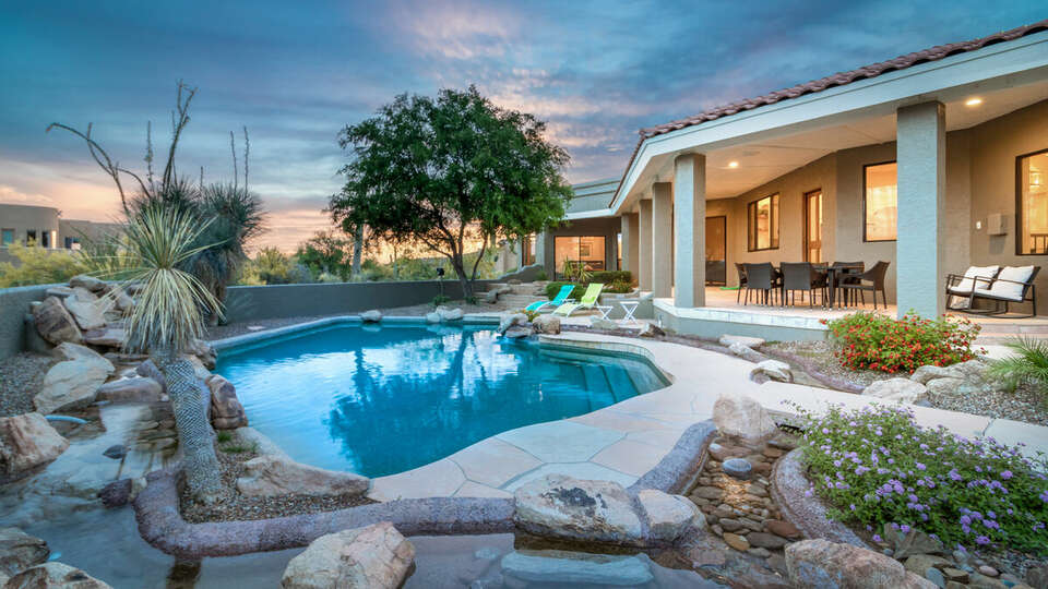 Incredible desert landscaping in this luxurious backyard.