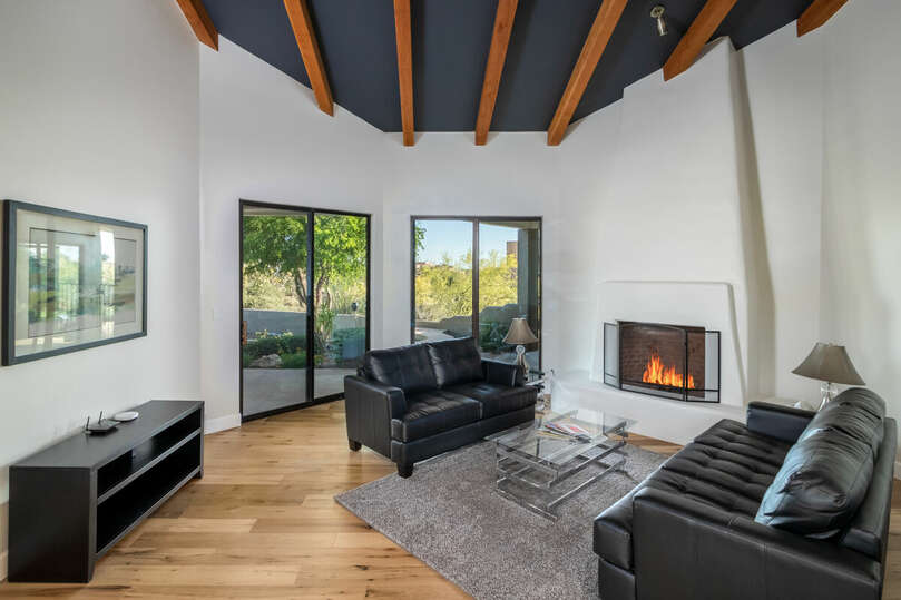 Living room seating area with fireplace.