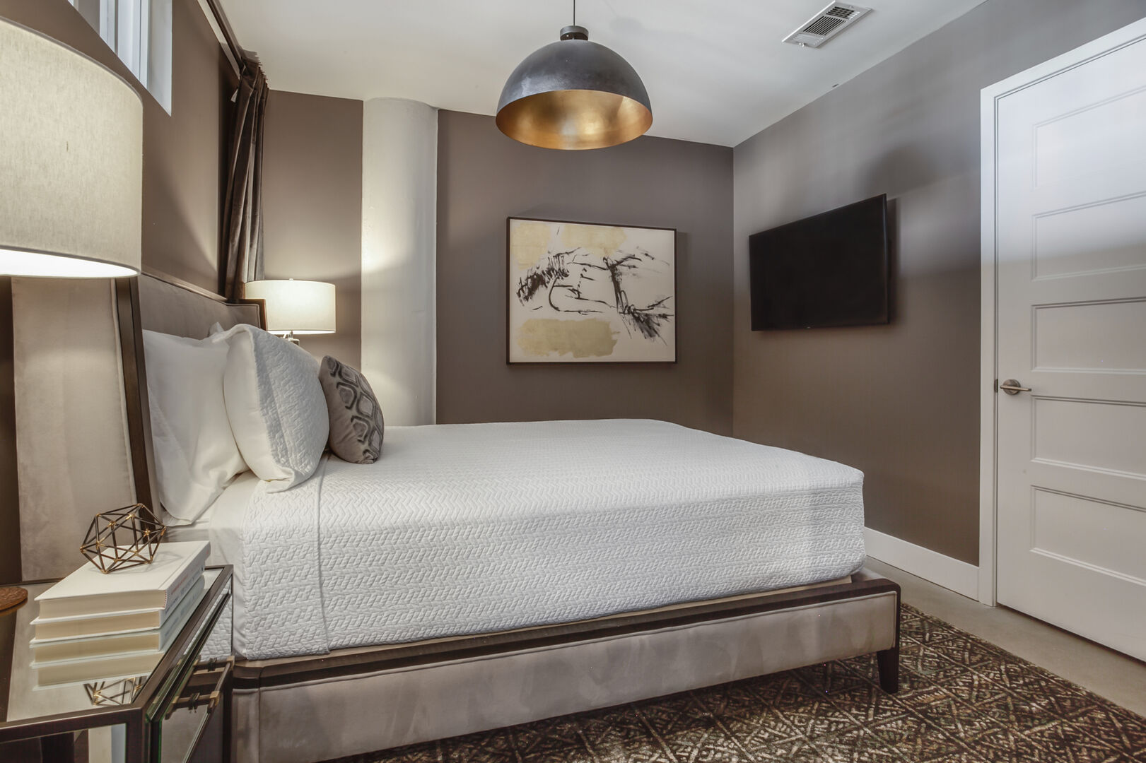 Guest Bedroom with Contemporary Furnishings at Sherwood Loft