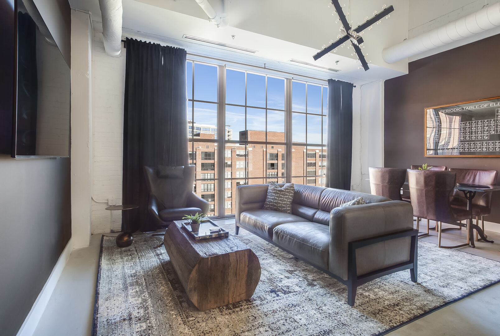 Living Area with City Views at Ponce City Market Apartment