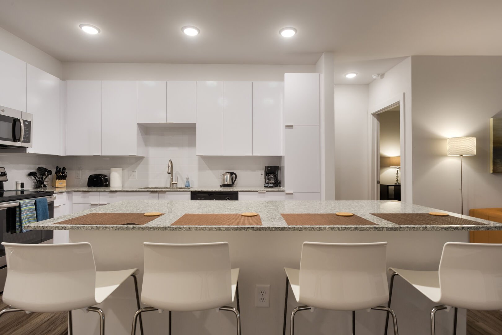 Fully Equipped Kitchen with Island Bar Seating - BCA Furnished Apartments - 2-Bedroom Spectacular Suites
