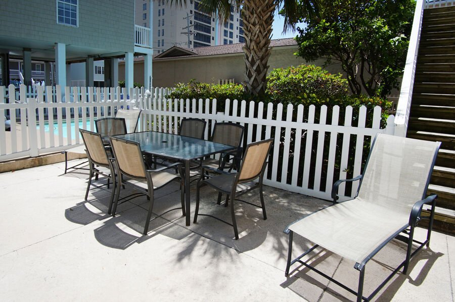Admirals Quarters A vacation home in Cherry Grove, North Myrtle Beach | pool deck table | Thomas Beach Vacations