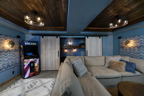 Theater Room with 2 Bunk Bed Behind Barn Doors