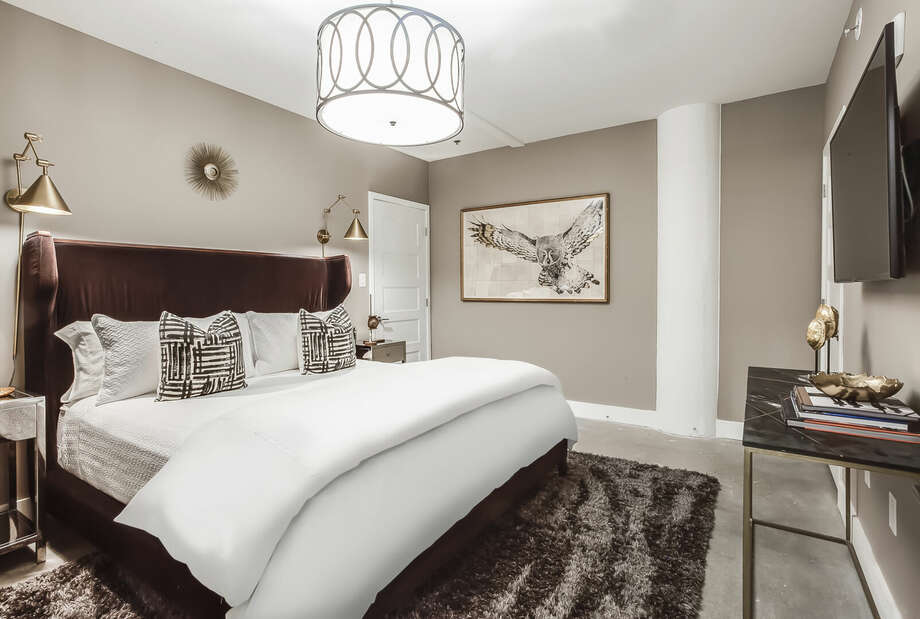 Master Bedroom with Flat Screen TV and Contemporary Furnishings