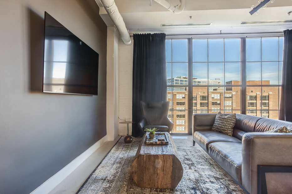 Living Area with HD-TV, Leather Sofa, and City Views